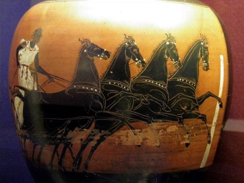 """A Greek vase depicting a charioteer and quadriga, found in Cyrenaica (modern Lybia). This vase was made in Athens would have been a prize given to the winner of the quadriga race at the Panhellenic Games.<br><font size=""""-2"""">Photo: Carole Raddato, Wikimedia Commons, CC BY SA</font><br><br>"""