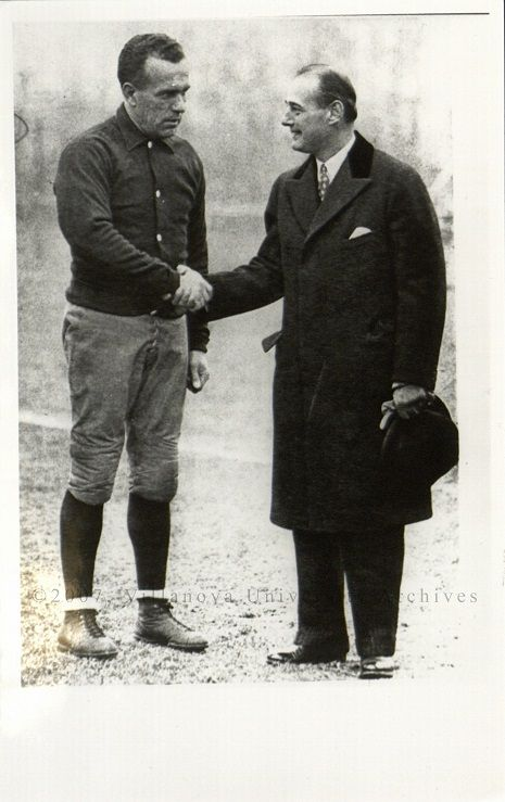 """""""Clipper"""" Smith and Harry Stuhldreher shaking Hands, [1925]. (Courtesy of the University Archives)"""