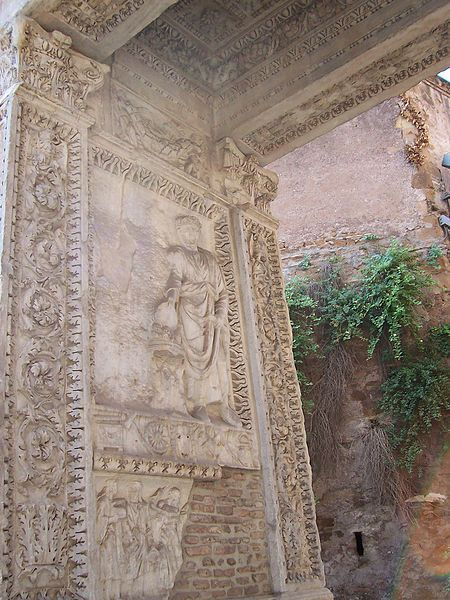 """Arch of Argentarii,<br><font size=""""-2"""">Detail """"Arco degli Argentarii, internal side; Caracalla and figure [Geta] cancelled"""" by Panairjdde. Licensed under Creative Commons Attribution-Share Alike 2.0 Generic license via Wikimedia Commons - http://commons.wikimedia.org/wiki/File:Arco_degli_Argentarii_-_Panairjdde.jpg</font><br>"""