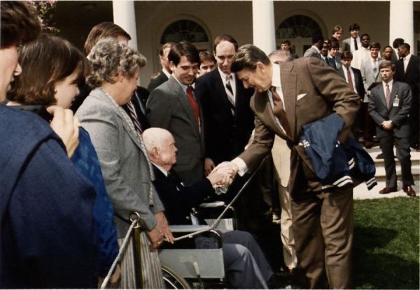 President Ronald Reagan shaking hands with Trainer Jake Nevin, 1985.