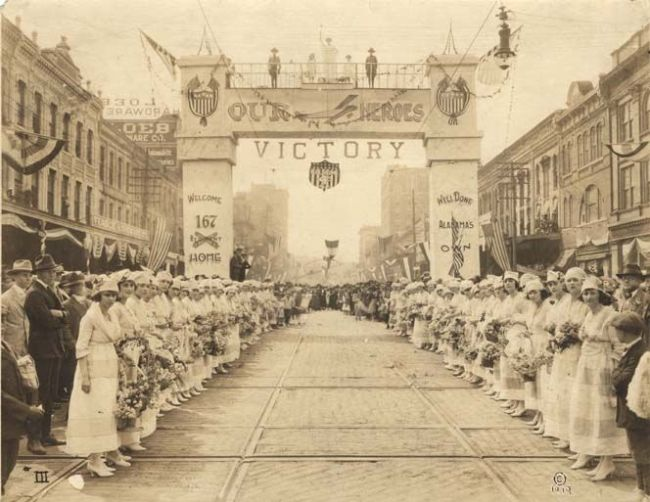 """Montgomery, Alabama. World War I Victory<br><font size=""""-2"""">Paulger, Stanley. World War I victory parade for the 167th Infantry regiment on Dexter Avenue in Montgomery, Alabama. 1919. Alabama Dept. of Archives and History. CC-PD-OLD. Image Public Domain@Wikimedia Commons. http://commons.wikimedia.org/wiki/File:Montgomery_Alabama_WWI_parade.jpg</font><br><br>"""