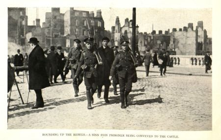 """Rounding up the Rebels,"" by T. W Murphy, in Dublin after the Six Days' Insurrection: Thirty-One Pictures From the Camera of Mr. T. W. Murphy, 1916, page 27."