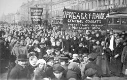 "A demonstration of workers from the Putilov plant in Petrograd (modern day St. Peterburg), Russia, during the February Revolution. The left banner reads (misspelt*) ""Feed [plural imperative] the children of the defenders of the motherland""; the right banner, ""Increase payments to the soldiers' families - defenders of freedom and world peace"". Image: Author unknown, Public Domain courtesy of the State museum of political history of Russia via <a href=""https://commons.wikimedia.org/wiki/File:%D0%94%D0%B5%D0%BC%D0%BE%D0%BD%D1%81%D1%82%D1%80%D0%B0%D1%86%D0%B8%D1%8F_%D1%80%D0%B0%D0%B1%D0%BE%D1%82%D0%BD%D0%B8%D1%86_%D0%9F%D1%83%D1%82%D0%B8%D0%BB%D0%BE%D0%B2%D1%81%D0%BA%D0%BE%D0%B3%D0%BE_%D0%B7%D0%B0%D0%B2%D0%BE%D0%B4%D0%B0_%D0%B2_%D0%BF%D0%B5%D1%80%D0%B2%D1%8B%D0%B9_%D0%B4%D0%B5%D0%BD%D1%8C_%D0%A4%D0%B5%D0%B2%D1%80%D0%B0%D0%BB%D1%8C%D1%81%D0%BA%D0%BE%D0%B9_%D1%80%D0%B5%D0%B2%D0%BE%D0%BB%D1%8E%D1%86%D0%B8%D0%B8_1917.jpg"">Wikimedia Commons.</a>"